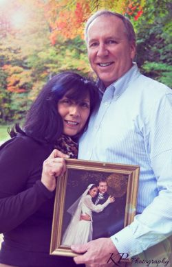 A portrait of my parents on their 30th Anniversary holding their wedding photo.